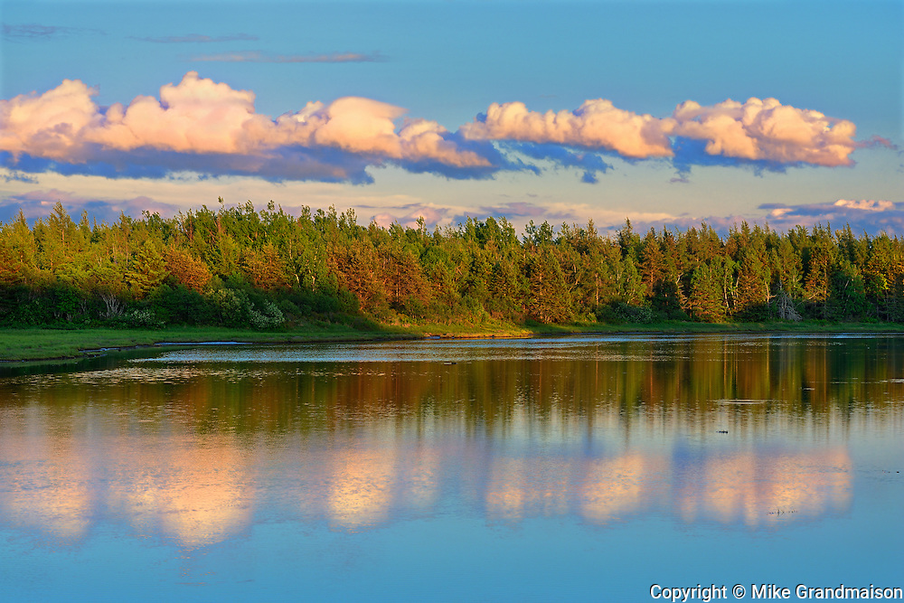Clouds reflected in an inlet at sunset<br /> Richibucto<br /> New Brunswick<br /> Canada