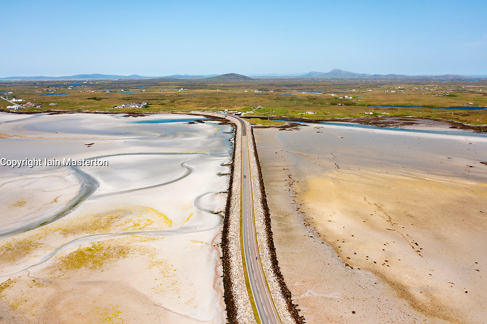 Aerial view from drone of Benbecula causeway linking Islands of Benbecula (top) to South Uist in the Outer Hebrides, Scotland, UK