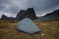 Tent at wild mountain campsite below Kråkhammartind, Moskenesøy, Lofoten Islands, Norway