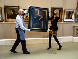 Pictured: Danny Mcilwraithn and May Matthews (Picture specialist) move Jack Vettriano's Night Geometry.<br /><br />A fabulous selection of paintings by the world-famous Scottish Colourists – Samuel Peploe, George Leslie Hunter, Francis Cadell and J.D Fergusson – lead the Bonhams Scottish Art sale.<br /><br />They include pictures from a fine private collection of Scottish Art led by Peploe's Still Life with Tureen and Fruit. Painted around 1926, Still Life with Tureen and Fruit shows the influence of the French Post-Impressionist master Paul Cézanne. Peploe's compositions were meticulously planned and executed, creating the dialogue between object and space for which he and his fellow Colourists were renowned  which is estimated at £120,000-180,000.<br /><br />Other Scottish Colourist works on show include:<br />Anemones in a Yellow Vase by George Leslie Hunter (1877-1931). Dating from the mid to late 1920s – a golden period for Hunter still lives – Anemones in a Yellow Vase shows the influence of Matisse on the artist's work. Estimate: £50,000-80,000.<br /><br />Gypsy in a Landscape by Peploe (1871-1935). Originally thought to be a portrait of Margaret, the artist's wife, dressed as a gypsy, the work painted around 1900 is now widely believed to depict one of the Blyth sisters, who were related to the kings of the Gypsies. Estimate: £60,000-80,000.<br /><br />Peonies in a Silver Vase by Peploe. In the 1890s, Peploe studied in Paris, where he was greatly influenced by the work of Edouard Manet, Jean-Baptiste-Camille Corot, Jean-Baptiste-Siméon Chardin and Gustave Courbet. During further training in Holland, he discovered the seventeenth-century Dutch painters, especially Frans Hals. From a distillation of these influences, he developed his own tonal style as seen in this work which he painted around 1897 shortly after he settled back in Edinburgh. Estimate: £60,000-80,000.<br /><br />Paris street scene by John Duncan Fergusson RBA (1874-1961). Between 1907 and 1914 