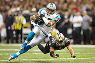 NEW ORLEANS, LA - DECEMBER 30:  Steve Smith #89 of the Carolina Panthers is tackled after making a catch by Patrick Robinson #21 of the New Orleans Saints at Mercedes-Benz Superdome on December 30, 2012 in New Orleans, Louisiana.  The Panthers defeated the Saints 44-38.  (Photo by Wesley Hitt/Getty Images) *** Local Caption *** Steve Smith; Patrick Robinson Sports photography by Wesley Hitt photography with images from the NFL, NCAA and Arkansas Razorbacks.  Hitt photography in based in Fayetteville, Arkansas where he shoots Commercial Photography, Editorial Photography, Advertising Photography, Stock Photography and People Photography