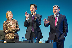 © Licensed to London News Pictures . 23/09/2013 . Brighton , UK . Harriet Harman and Ed Miliband applaud following Ed Balls ' , MP for Morley and Outwood and Shadow Chancellor of the Exchequer , address to the conference this afternoon (Monday 23rd September 2013) . Day 2 of the Labour Party 's annual conference in Brighton . Photo credit : Joel Goodman/LNP