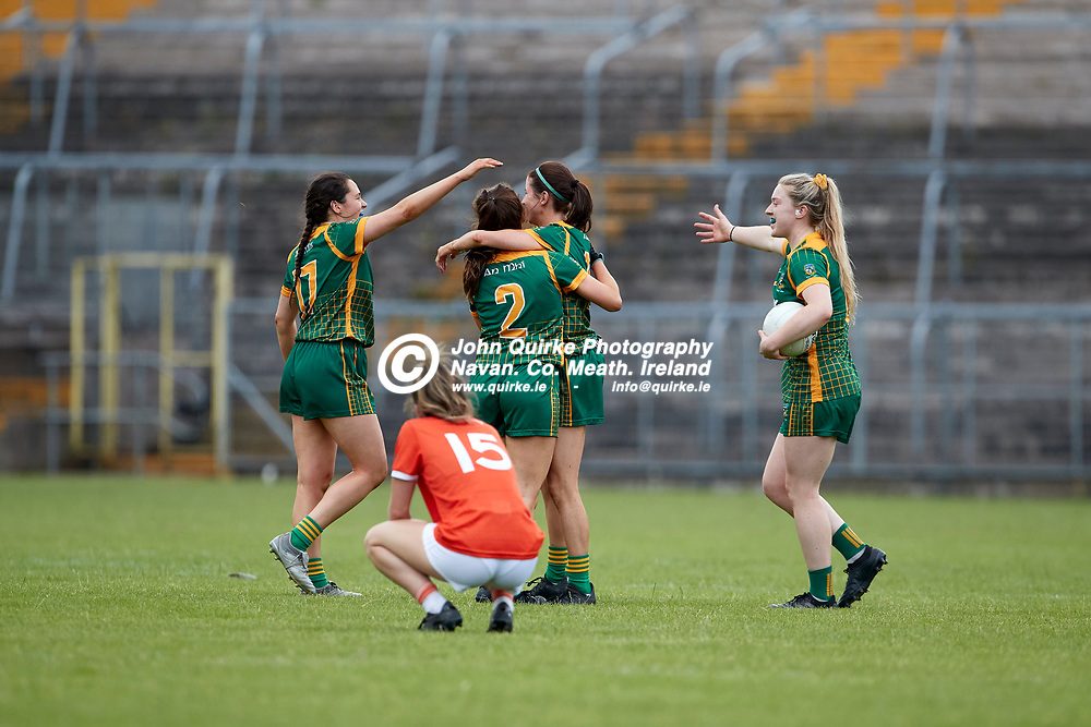 01-08-21, All Ireland Ladies SFC quarterfinal at Clones<br /> Meath v Armagh<br /> Meath players celebrate at the final whistle while Armaghs Alexandra Clarke looks on dejected<br /> Photo: David Mullen / www.quirke.ie ©John Quirke Photography, Proudstown Road Navan. Co. Meath. 046-9079044 / 087-2579454.<br /> ISO: 500; Shutter: 1/1250; Aperture: 4.5;