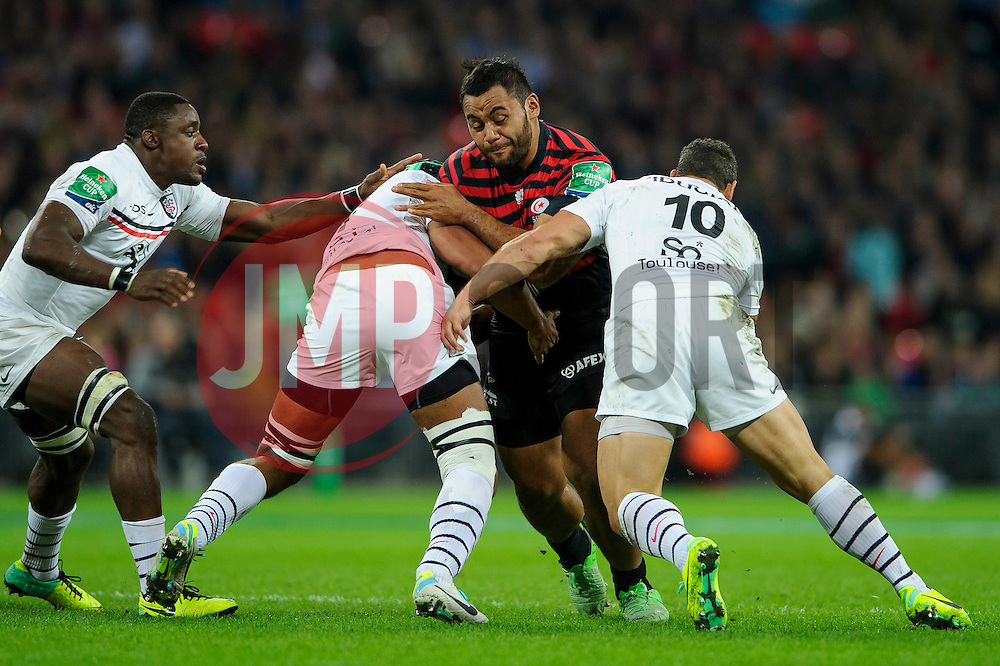 Saracens Number 8 (#8) Ernst Joubert is tackled by Toulouse Fly-Half (#10) Luke McAlister during the first half of the match - Photo mandatory by-line: Rogan Thomson/JMP - Tel: 07966 386802 - 18/10/2013 - SPORT - RUGBY UNION - Wembley Stadium, London - Saracens v Toulouse - Heineken Cup Round 2.