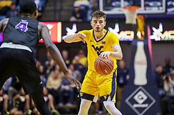 Mar 20, 2019; Morgantown, WV, USA; West Virginia Mountaineers guard Jordan McCabe (5) calls out a play during the second half against the Grand Canyon Antelopes at WVU Coliseum. Mandatory Credit: Ben Queen