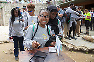 Alexia Smith, 13, joins the other kids in getting their passports stamped as they leave Machu Picchu.