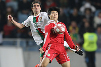 20100303: COIMBRA, PORTUGAL - Portugal vs China: International Friendly. In picture: Pedro Mendes (Portugal) and Jiang Ning (China). PHOTO: CITYFILES