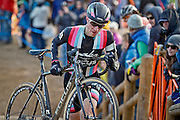 SHOT 1/12/14 4:35:08 PM - Jeremy Powers (#3) of Easthampton, Ma. runs with his bike in the 5280' Run Up section as he competes in the Men's Elite race at the 2014 USA Cycling Cyclo-Cross National Championships at Valmont Bike Park in Boulder, Co. Powers won the event with a time of 59:16.  (Photo by Marc Piscotty / © 2014)
