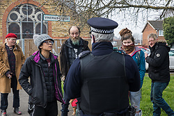 Sipson, UK. 8th March, 2021. A Metropolitan Police officer facilitates the eviction of residents from the remaining section of a squatted off-grid eco-community garden known as Grow Heathrow. Grow Heathrow was founded in 2010 on a previously derelict site close to Heathrow airport in protest against government plans for a third runway and has since made a significant educational and spiritual contribution to life in the Heathrow villages which are threatened by airport expansion.