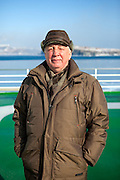 """Portrait of a Russian passenger from Vladivostok on the """"Eastern Dream"""" ferry during arrival to the sea port of Vladivostok in Russia. Vladivostok, Russian Federation, Russia, RUS, 12.01.2010."""