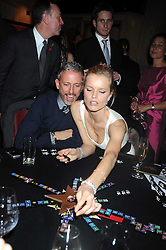 PATRICK COX and EVA HERZIGOVA at a party to celebrate the launch of Hollywood Domino - a brand new board game, held at Mosimann's 11b West Halkin Street, London on 7th November 2008.  The evening was in aid of Charlize Theron's Africa Outreach Project.