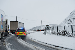© Licensed to London News Pictures. 11/02/2014. Ponterwyd , UK Heavy overnight snow forces the closure of the main A44 trunk road at Nant yr Arian near Ponterwyd 13 miles inland from Aberystwyth over the Cambrian mountain in mid wales this morning.. Photo credit : Keith Morris/LNP