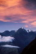 Sunset turns clouds orange over the Cordillera Vilcabamba, Andes mountains, along the Inca Trail, Peru, South America.