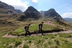 File photo dated 30/05/2013 of walkers near the Three Sisters mountain range in the Highlands as fresh investment has been announced by the Scottish Government to help promote the scenery, wildlife and culture of the Highlands and Islands.