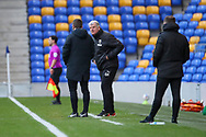 AFC Wimbledon manager Glyn Hodges talking to fourth official during the EFL Sky Bet League 1 match between AFC Wimbledon and Lincoln City at Plough Lane, London, United Kingdom on 2 January 2021.