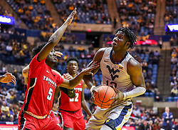 Dec 1, 2018; Morgantown, WV, USA; West Virginia Mountaineers forward Andrew Gordon (12) attempts to make a move in the lane while defended by Youngstown State Penguins guard Kendale Hampton (5) during the first half at WVU Coliseum. Mandatory Credit: Ben Queen-USA TODAY Sports