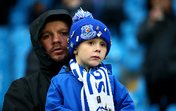 A young Everton fan in the stands prior to the match