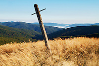 Cross marking the borderland trail between Poland (in the background) and Slovakia on the peak of Mount Durkovec (1189m), Runina area, Slovakia.