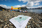 Beaver float plane unloading gear at Kisaralik Lake at beginning of 10-day raft  trip down Kisaralik River, Alaska.