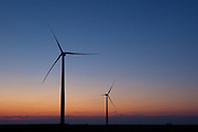 New wind generators stand ready. The new rural economy.