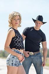 cowboy looking at a hot girl outdoors