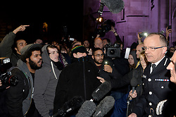 Mark Duggan's family speak to press outside of the The High Court after the jury reach a decision at the Mark Duggan inquest.<br /> <br /> Protesters shout at Assistant Commissioner Mark Rowley (far right) as he speaks to the press. <br /> <br /> Wednesday, 8th January 2014. Picture by Ben Stevens / i-Images