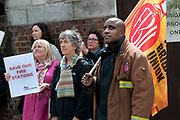 Belsize Park, London, residents join firefighters to protest at proposed closure of the local fire station.