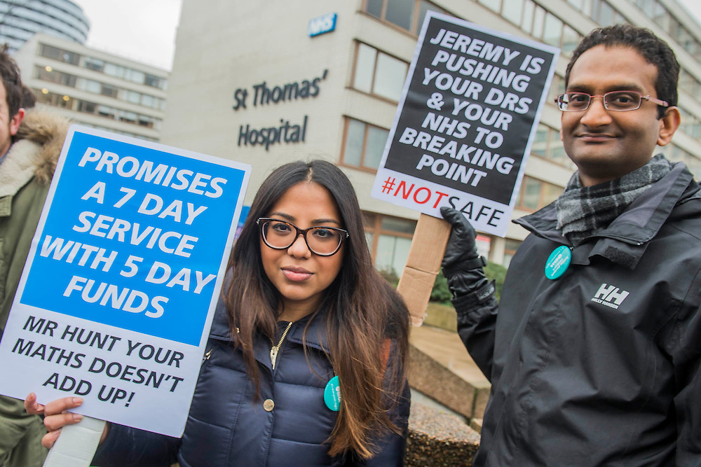 Ruha Chowdhury (L) and another Registrar (who is heading to Australia in 3 weeks) join the protest - The picket line at St Thomas' Hospital. Junior Doctors stage another 48 hours of strike action against the new contracts due to be imposed by the Governemnt and health minister Jeremy Hunt.