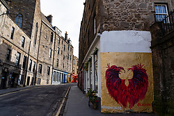 View of Candlemakers Row street and street art in Edinburgh Old Town, Scotland, Uk
