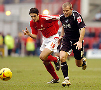 Photo: Leigh Quinnell.<br /> Nottingham Forest v Swansea. Coca Cola League 1. 11/02/2006. Swanseas Andy Robinson races away from Nottingham Forests  John Thompson.