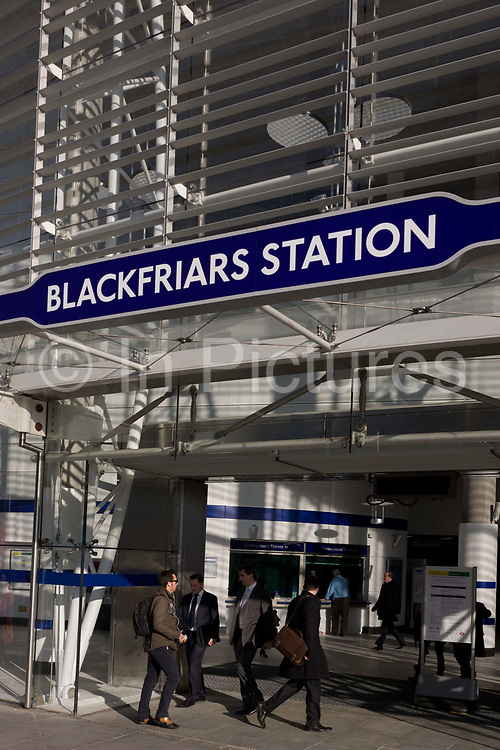 Londoners commuting through the entrance of the newly-finished Blackfriars mainline Station in the City of London. A larger and more accessible Blackfriars Underground station reopened for public service to accommodate more than 40,000 passengers every day. Blackfriars station was opened as St Paul's by the London Chatham and Dover Railway (LC&DR) in May 1886. St Paul's station was renamed Blackfriars on 1 February 1937 and is now a central London railway terminus and London Underground complex in the City of London. Its platforms span the River Thames a short distance downstream from Blackfriars Bridge.