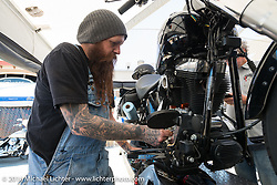 Dan Reiman changing out the cams in the Kuryakyn booth at Destination Daytona Harley-Davidson during the Daytona Bike Week 75th Anniversary event. FL, USA. Sunday March 6, 2016.  Photography ©2016 Michael Lichter.