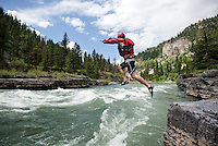 Alan Larson leaps into the Snake River while taking a break from kayaking on the Lunch Counter Rapid on Friday afternoon.