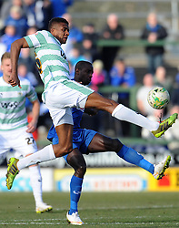 Yeovil Town's Stephen Arthurworrey is tackled by Oldham Athletic's Jonathan Forte  - Photo mandatory by-line: Harry Trump/JMP - Mobile: 07966 386802 - 07/03/15 - SPORT - Football - Sky Bet League One - Yeovil Town v Oldham Athletic - Huish Park, Yeovil, England.