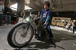 "Kaichiroh ""Kross"" Kurosu of Cherry's Company in Tokyo on the 2014 Mooneyes Best-of-Show 1975 HD Shovelhead at the Mooneyes Yokohama Hot Rod & Custom Show. Yokohama, Japan. December 6, 2015.  Photography ©2015 Michael Lichter."
