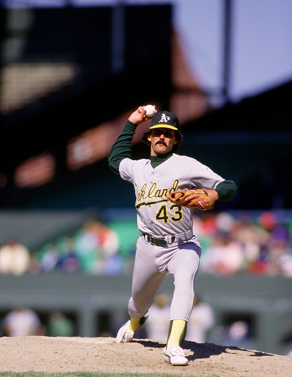 CHICAGO - 1988:  Dennis Eckersley of the Oakland Athletics pitches during an MLB game against the Chicago White Sox at Comiskey Park in Chicago, Illinois during the 1988 season. (Photo by Ron Vesely)  Subject:  Dennis Eckersley