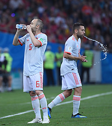 SOCHI, June 15, 2018  Spain's Andres Iniesta (L) drinks water during a group B match between Portugal and Spain at the 2018 FIFA World Cup in Sochi, Russia, June 15, 2018. (Credit Image: © Li Ga/Xinhua via ZUMA Wire)