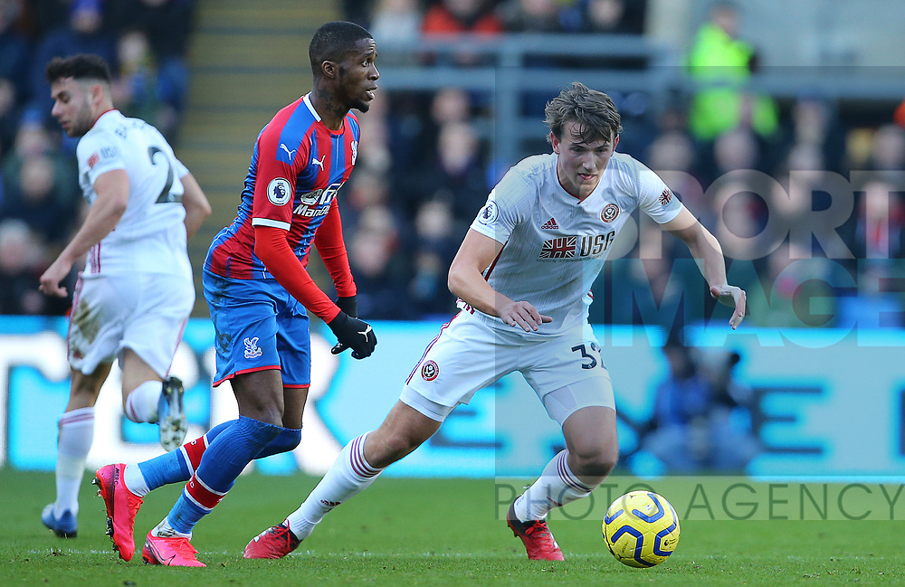 Crystal Palace's Wilfried Zaha is challenged by Sheffield United's Sander Berge during the Premier League match at Selhurst Park, London. Picture date: 1st February 2020. Picture credit should read: Paul Terry/Sportimage