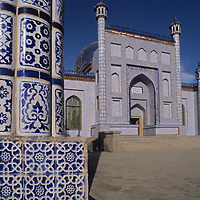 Ornate tiles decorate the minarets, walls and dome of Yusuf Khass Hajib Tomb in Kashgar (Kashi) a town on the Silk Road in Xinjiang, in far western China. This was built to honor an 11th century Turkic poet.