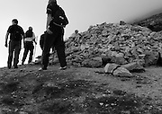 As part of their penance, pilgrims walk seven times around stations on the mountain in prayer.