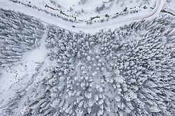 THEMENBILD - Schneebedeckte Bäume im Wald entlang der Kalser Landesstrasse L026, am Donnerstag 10. Dezember 2020 in Kals. Luftbild mit einer Drohnen nach den starken Schneefällen welche vom 5. bis 8. Dezember 2020 für grosse Neuschneemengen in Oberkärnten und Osttirol sorgten // Snow covered trees in the forest along the Kalser Landesstrasse L026, on Thursday December 10, 2020 in Kals. Photo taken with a drone after the heavy snowfalls which caused large amounts of new snow in Upper Carinthia and East Tyrol from December 5th to 8th, 2020. EXPA Pictures © 2020, PhotoCredit: EXPA/ Johann Groder