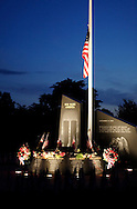 Washingtonville, N.Y. - The Washingtonville 5 Firefighters World Trade Center Memorial at twilight before a candlelight service on Sept. 11, 2006. The Memorial was built in honor of five FDNY firefighters from Washingtonville and the many others who lost their lives on September 11, 2001 in the World Trade Center terrorist attack.<br />