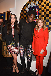 Left to right, Lily Fortescue, artist Bradley Theodore and Rosie Fortescue at a private view of work by Bradley Theodore entitled 'The Second Coming' at the Maddox Gallery, 9 Maddox Street, London England. 19 April 2017.