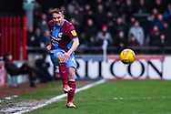 Anthony McMahon of Scunthorpe United (4) clears the ball during the EFL Sky Bet League 1 match between Scunthorpe United and Sunderland at Glanford Park, Scunthorpe, England on 19 January 2019.