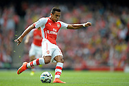 Arsenal's Alexis Sanchez taking a shot. Barclays Premier league match, Arsenal v Manchester city at the Emirates Stadium in London on Saturday 13th Sept 2014.<br /> pic by John Patrick Fletcher, Andrew Orchard sports photography.