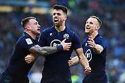 Adam Hastings of Scotland celebrates with his teammates after scoring during the Guinness Six Nations 2020, rugby union match between Italy and Scotland, Saturday Feb. 22, 2020,in Rome, Italy. (Federico Proietti/ESPA-Images-Image of Sport)