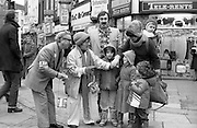 08/12/1977.12/08/1977.8th December 1977.Picture of Maureen Potter & Danny Cummins collecting money for Concern from members of the public.
