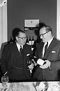 18/04/1963<br /> 04/18/1963<br /> 18 April 1963<br /> Friends of the Wine Club group inaugurated at the House of Morgan, 36 Dawson Street, Dublin.  Picture shows John Morgan (right), Chairman of the House of Morgan, pouring for fellow Director Felix Hughes during the reception