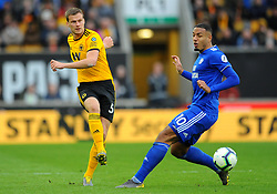 Ryan Bennett of Wolverhampton Wanderers competes with Kenneth Zohore of Cardiff City - Mandatory by-line: Nizaam Jones/JMP - 02/03/2019 - FOOTBALL - Molineux - Wolverhampton, England -  Wolverhampton Wanderers v Cardiff City - Premier League