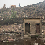 Garbage collectors in smog. A visit to one of the main garbage dump. With 15 millions population in 2019 and growing, the city of Calcutta is a typical case of expansion through uncontrolled urbanization.